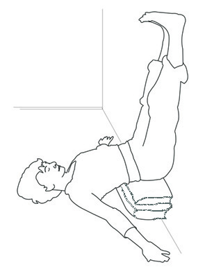 Restorative inverted, legs up the wall pose with pelvis elevated.